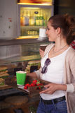 Best friends ladies in cafe. Cheerful woman having break in cafe or restaurant. Sandwiches and snacks concepts. Toned image of happy ladies choosing dishes for Stock Image