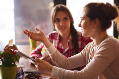 Best friends ladies in cafe. Toned picture of communication between best friends ladies while spending their free time or weekends in cafe or rstaurant Royalty Free Stock Photography