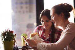 Best friends ladies in cafe Stock Photos