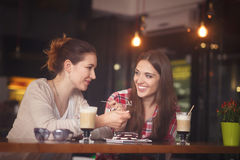 Best friends ladies having date. Toned picture of best friends having date in cafe or restaurant. Beautiful girls talking or communicating while drinking coffee Royalty Free Stock Image