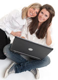 Best friends with laptop Royalty Free Stock Photos