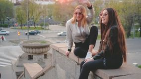 Best friends meeting urban streets sunset. Best friends meeting. Urban streets, sunset background. Girls greeting their bestie with high five stock footage