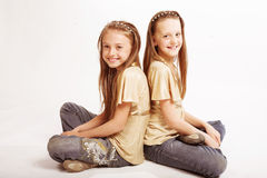 Best friends over white background. Two little blond Girls over white background Royalty Free Stock Photos