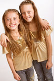 Best friends over white background. Two little blond Girls over white background Royalty Free Stock Image