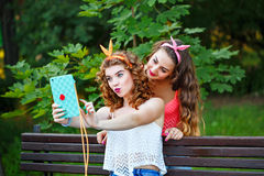 Best friends in park. Group selfies. Stock Images