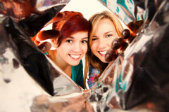 Best friends peeking to the bag Royalty Free Stock Photos
