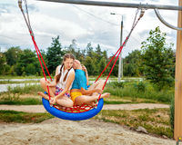 Best friends ride on a swing. royalty free stock photos