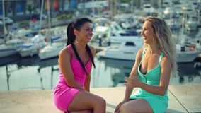 Best friends or sisters sitting and talking showing lovely relationship. They look happy stock footage