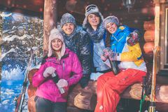 Friends spend winter holidays at mountain cottage. Best friends spend winter holidays at mountain cottage Royalty Free Stock Photography
