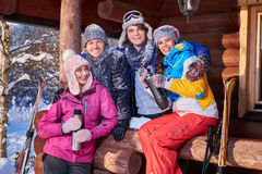 Best friends spend winter holidays at mountain cottage Stock Photography