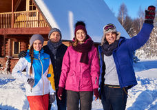 Best friends spend winter holidays at mountain cottage Stock Images