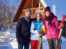 Best friends spend winter holidays at mountain cottage Stock Image