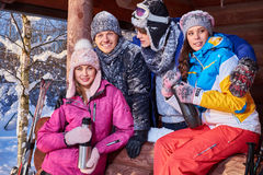 Best friends spending winter holidays at mountain cottage Royalty Free Stock Photo