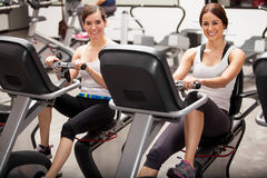 Best friends in spinning class Royalty Free Stock Images