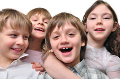 Best friends. Studio portrait of a group of four happy smiling elementary age children. Best friends. Isolated over white Royalty Free Stock Photography