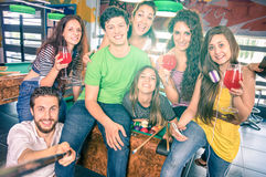Best friends taking selfie at billiard pool table with back ligh Stock Photography