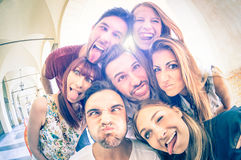 Best friends taking selfie and having fun together. Best friends taking selfie outdoors with back lighting - Happy friendship concept with young people having royalty free stock images