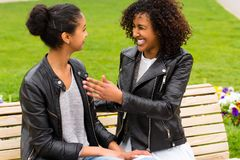 Best friends talking and having fun in park Royalty Free Stock Image