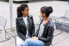 Best friends talking and having fun in park Royalty Free Stock Photos