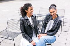 Best friends talking and having fun in park Royalty Free Stock Images