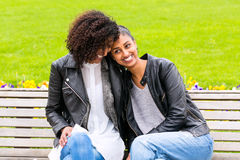 Best friends talking and having fun in park Stock Photography