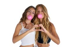 Best friends teen girls with bubble gum Royalty Free Stock Images