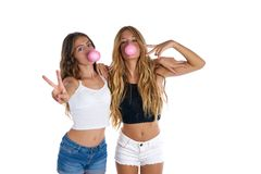 Best friends teen girls with bubble gum royalty free stock image