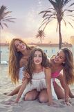 Best friends teen girls fun in a beach sunset. Best friends teen girls having fun on a beach sand at sunset filtered image Royalty Free Stock Photos