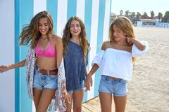 Best friends teen girls group happy in summer. Best friends teen girls group happy in a summer blue stripes background Stock Images