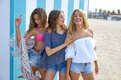 Best friends teen girls group happy in summer. Best friends teen girls group happy in a summer blue stripes background Royalty Free Stock Photos