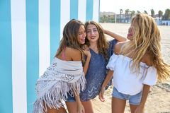 Best friends teen girls group happy in summer. Best friends teen girls group happy in a summer blue stripes background Stock Photo