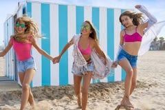 Best friends teen girls running happy in beach. Best friends teen girls group running happy in a beach having fun Stock Photos