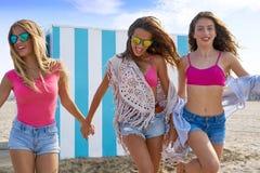 Best friends teen girls running happy in beach. Best friends teen girls group running happy in a beach having fun Stock Photo