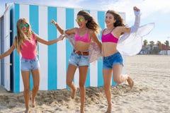 Best friends teen girls running happy in beach. Best friends teen girls group running happy in a beach having fun Stock Images