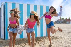 Best friends teen girls running happy in beach stock photography