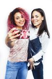Best friends teenage girls together having fun, posing emotional isolated on white background, asian and latin american stock photo