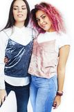 Best friends teenage girls together having fun, posing emotional isolated on white background, asian and latin american. Womancheerful, lifestyle people concept stock photography