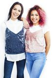 Best friends teenage girls together having fun, posing emotional isolated on white background, asian and latin american stock photography