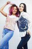 Best friends teenage girls together having fun, posing emotional  on white background, asian and latin american. Womancheerful, lifestyle people concept closeup stock images
