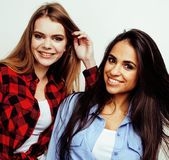 Best friends teenage girls together having fun, posing emotional on white background, besties happy smiling, lifestyle Royalty Free Stock Photography