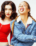 Best friends teenage girls together having fun, posing emotional on white background, besties happy smiling, lifestyle Royalty Free Stock Image