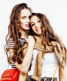 Best friends teenage girls together having fun, posing emotional on white background, besties happy smiling, lifestyle Stock Photos