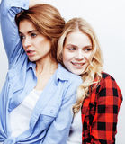 Best friends teenage girls together having fun, posing emotional on white background, besties happy smiling, lifestyle. People concept close up. making selfie Royalty Free Stock Photography
