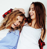 Best friends teenage girls together having fun, posing emotional on white background, besties happy smiling, lifestyle. People concept close up Stock Image