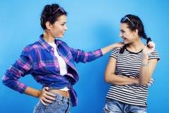 Best friends teenage school girls together having fun, posing emotional on blue background, besties happy smiling Stock Images