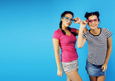 Best friends teenage school girls together having fun, posing emotional on blue background, besties happy smiling Stock Images