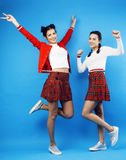 Best friends teenage school girls together having fun, posing emotional on blue background, besties happy smiling Stock Photography