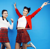 Best friends teenage school girls together having fun, posing emotional on blue background, besties happy smiling. Lifestyle people concept close up Royalty Free Stock Photo