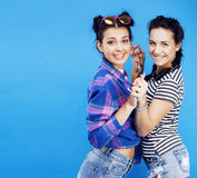 Best friends teenage school girls together having fun, posing emotional on blue background, besties happy smiling. Lifestyle people concept close up Stock Image