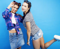 Best friends teenage school girls together having fun, posing emotional on blue background, besties happy smiling. Lifestyle people concept close up Royalty Free Stock Photography